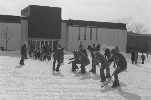 Vintage photo of a game of tug-of-war outside Arts Lecture Hall.