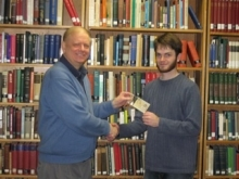 Paul Thagard awards Jessey Wright his $100 prize.