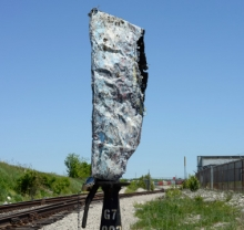 large stone by railway tracks