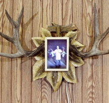 antlers and photo on wall
