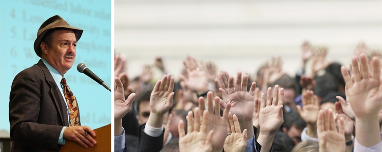 Economist lecturing and crowd of hands
