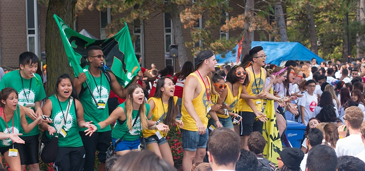 Students cheering during orientation week.