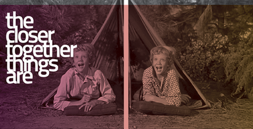exhibition image showing film still of twins in a tent