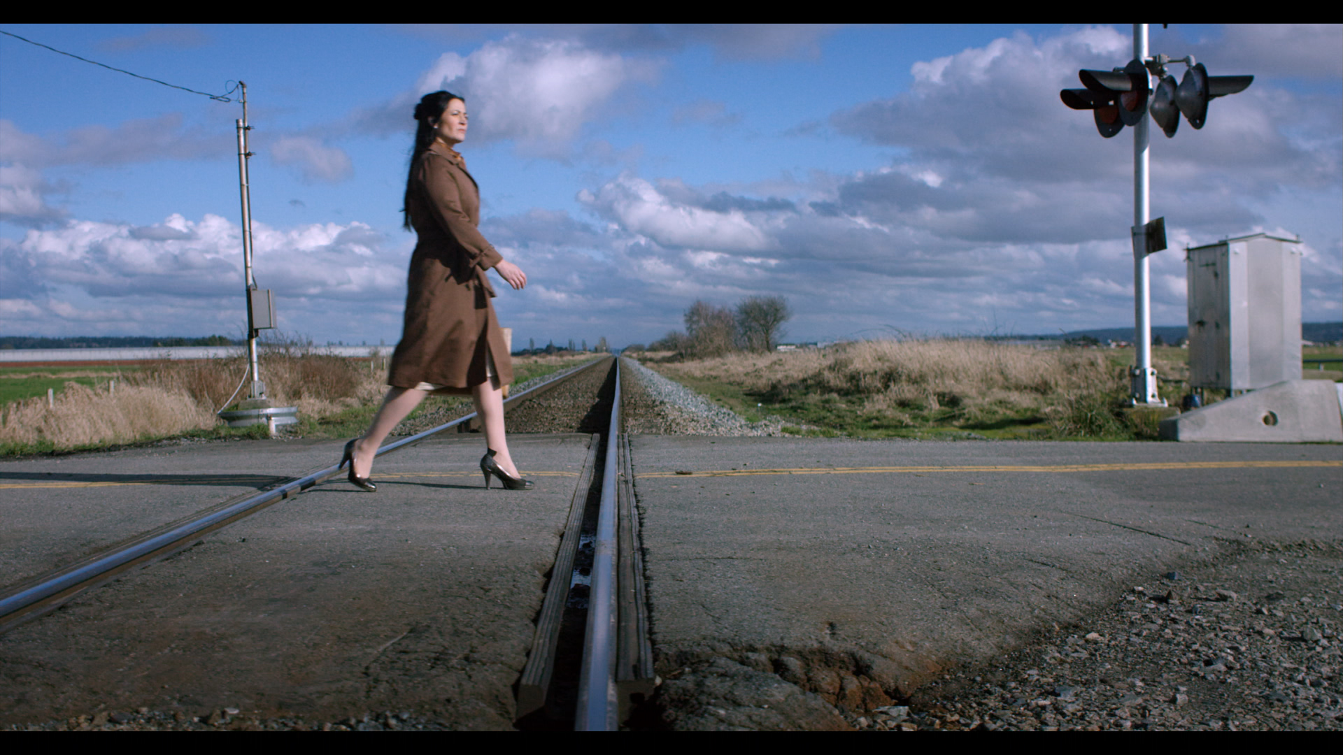 woman walking down rural road