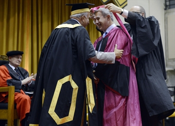Tom Jenkins is hooded at Arts convocation