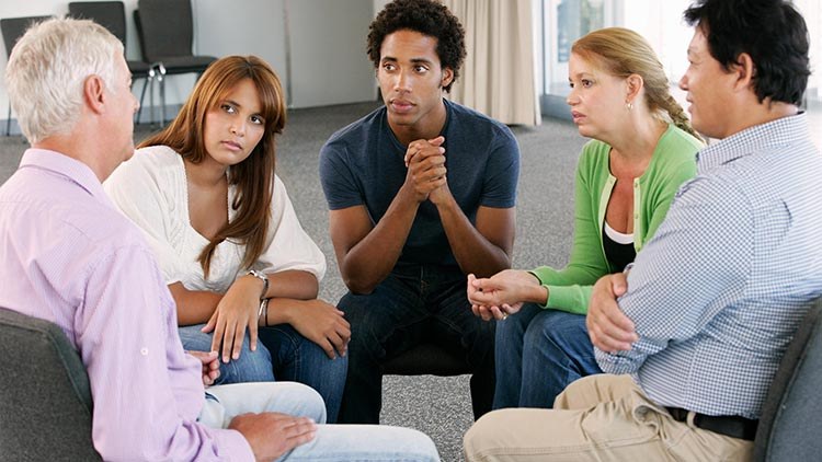 Young people in a group therapy session