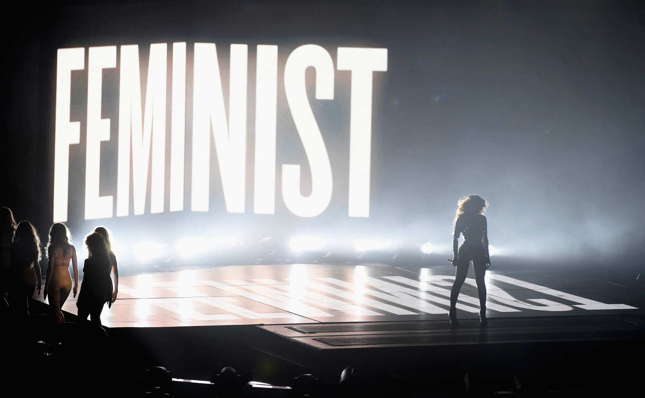 Beyonce on stage with the word 'Feminist' in lights