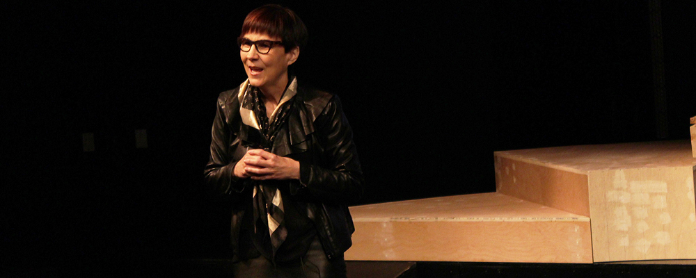 Cindy Blackstock on stage speaking