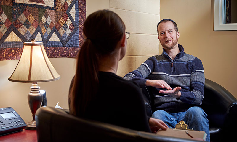 A counsellor works with a client