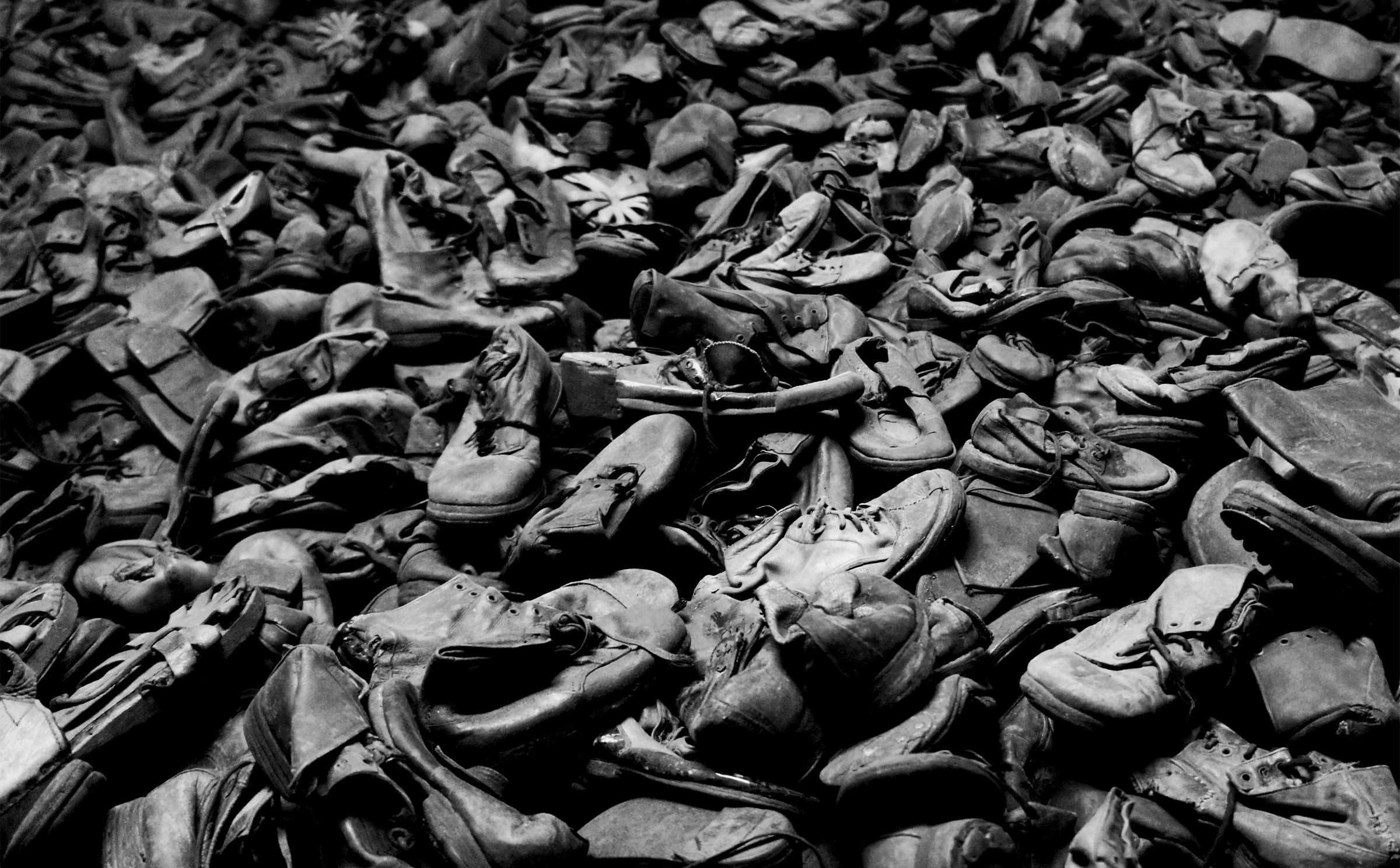 huge pile of old leather shoes