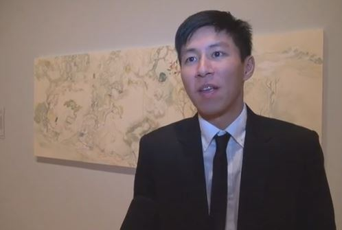 Howie Tsui standing in front of his artwork at National Gallery