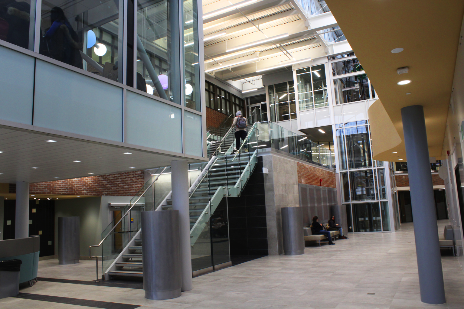 entrance to atrium area with stairs to upper level