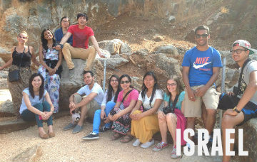 International trade specialization students pose for a photo while exploring the socio-political significance of the Galilee district.