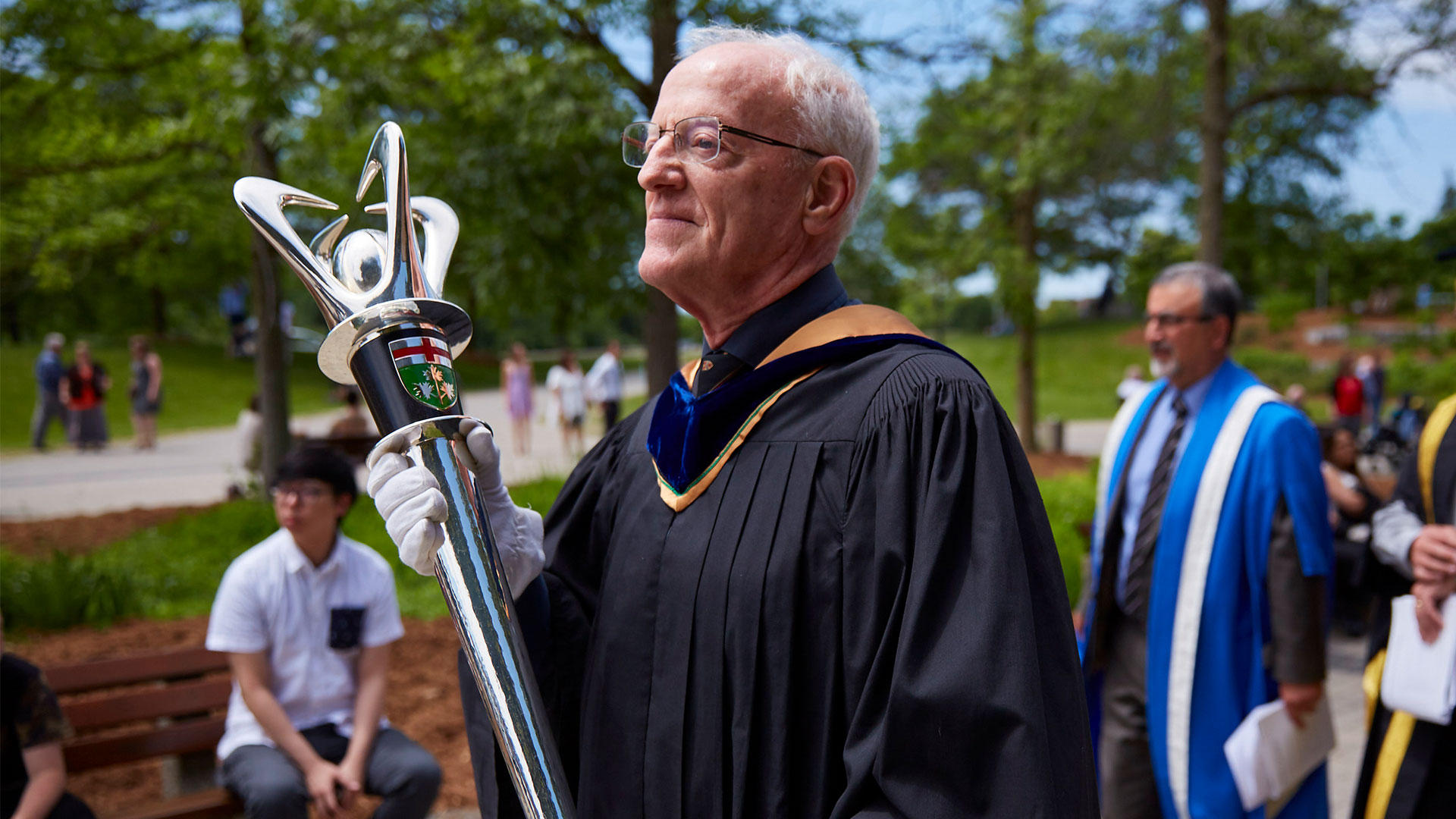 John North at convocation carrying the UWaterloo ceremonial mace