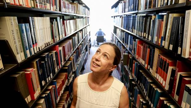 Katherien Acheson between library stacks