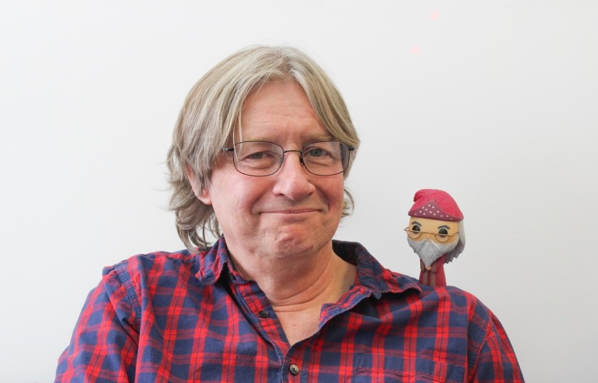 Neil Randall with puppet on his shoulder