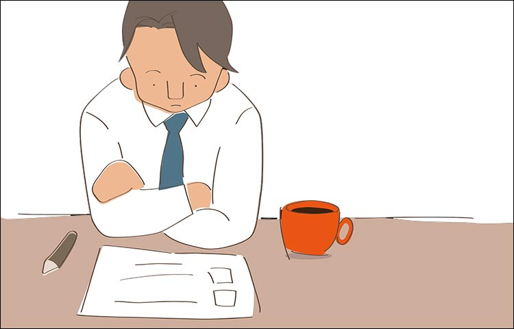 Cartoon of a sad office worker unable to work