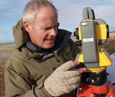 Robert Park with surveying instruments in high arctic