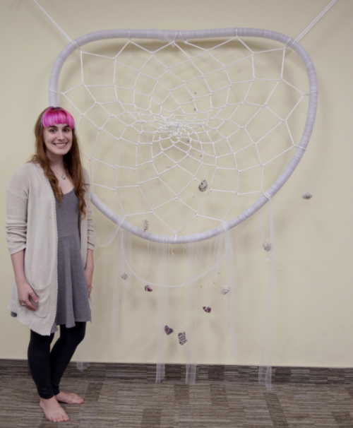 Melissa in front of 6 foot tall dream catcher