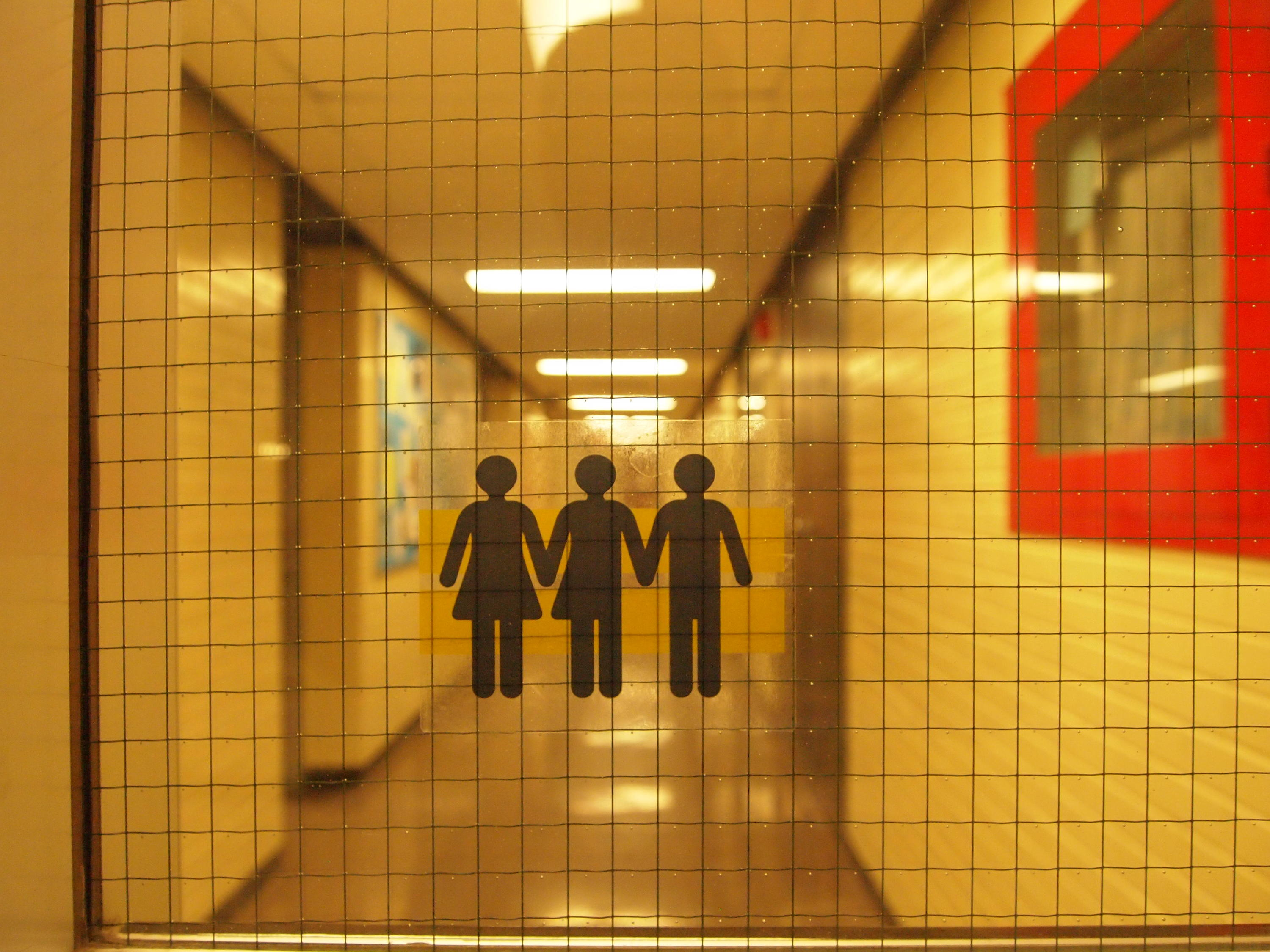 symbols for three or more genders on sticker on glass door