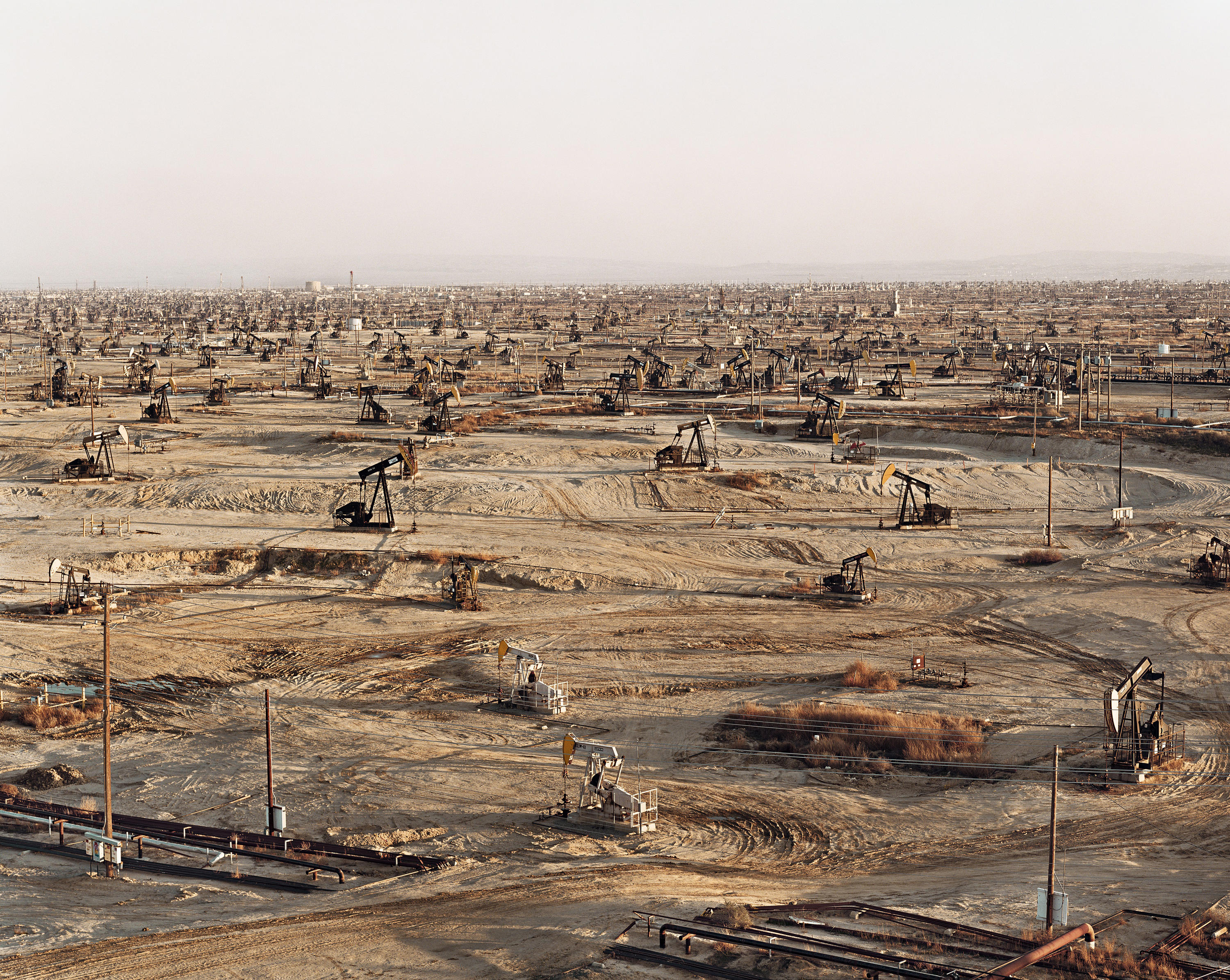 Dirt field of oil derriks