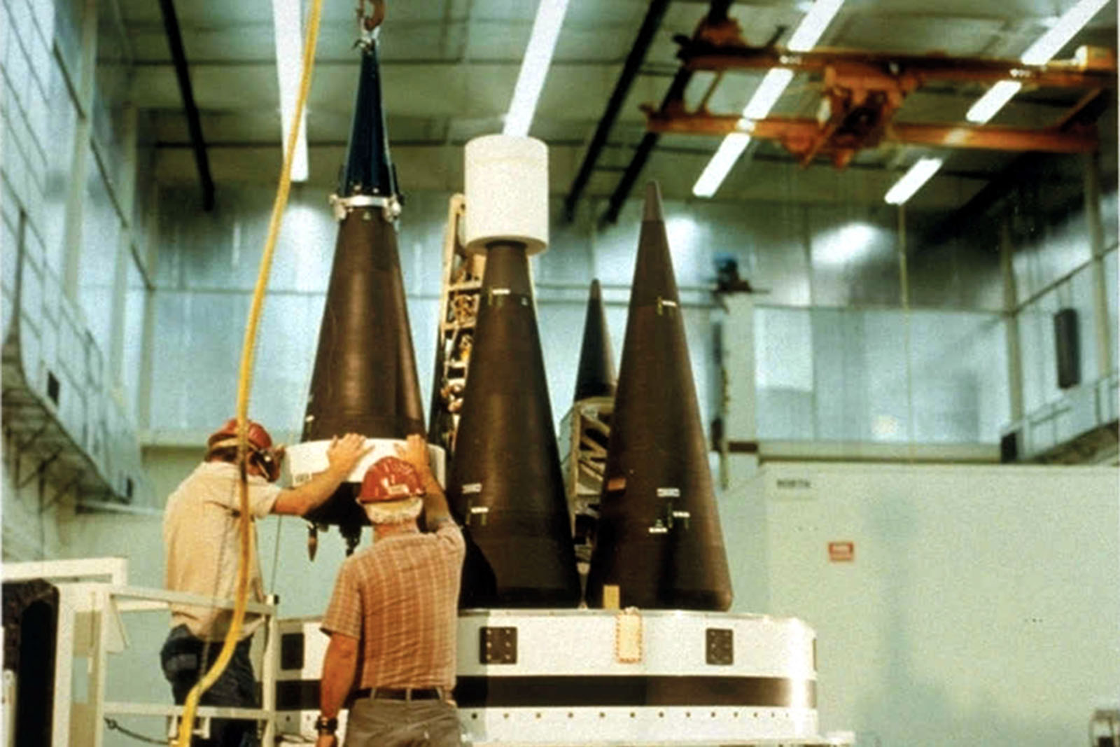 Two workers working with nuclear weapons
