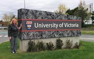 Christine Wagner next to University of Victoria sign