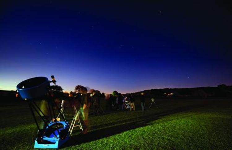 Night sky with telescopes