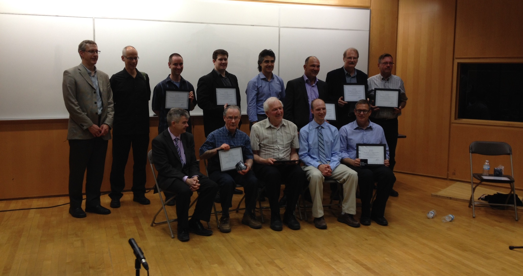 Audio Research Group photo holding awards