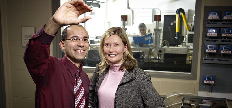 Faculty member, Karim S Karim, holds up a chip to show Catherine Burns, Centre Director