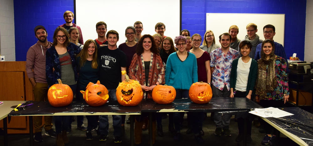 Biology graduate students with their final pumpkin carving creations.