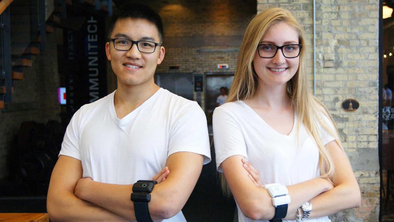 Daniel Choi and Alexa Roeper wear their medical arm bands