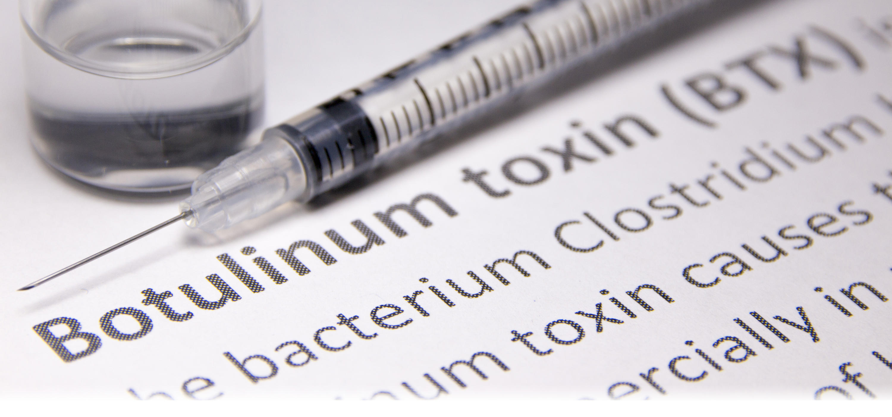 Needle with text saying botulium toxin.