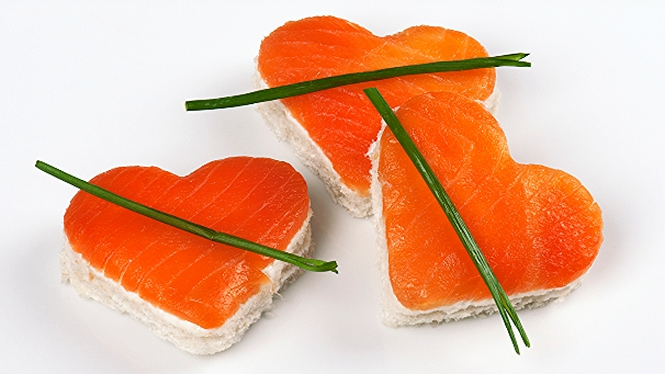 Smoked salmon filets shaped as hearts.