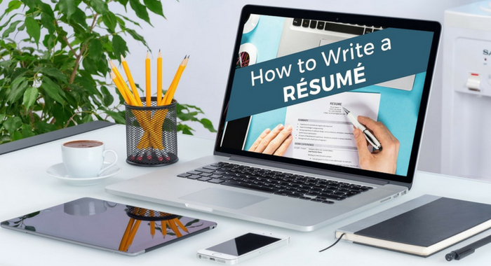 Laptop on desk with how to write a resume on the screen.