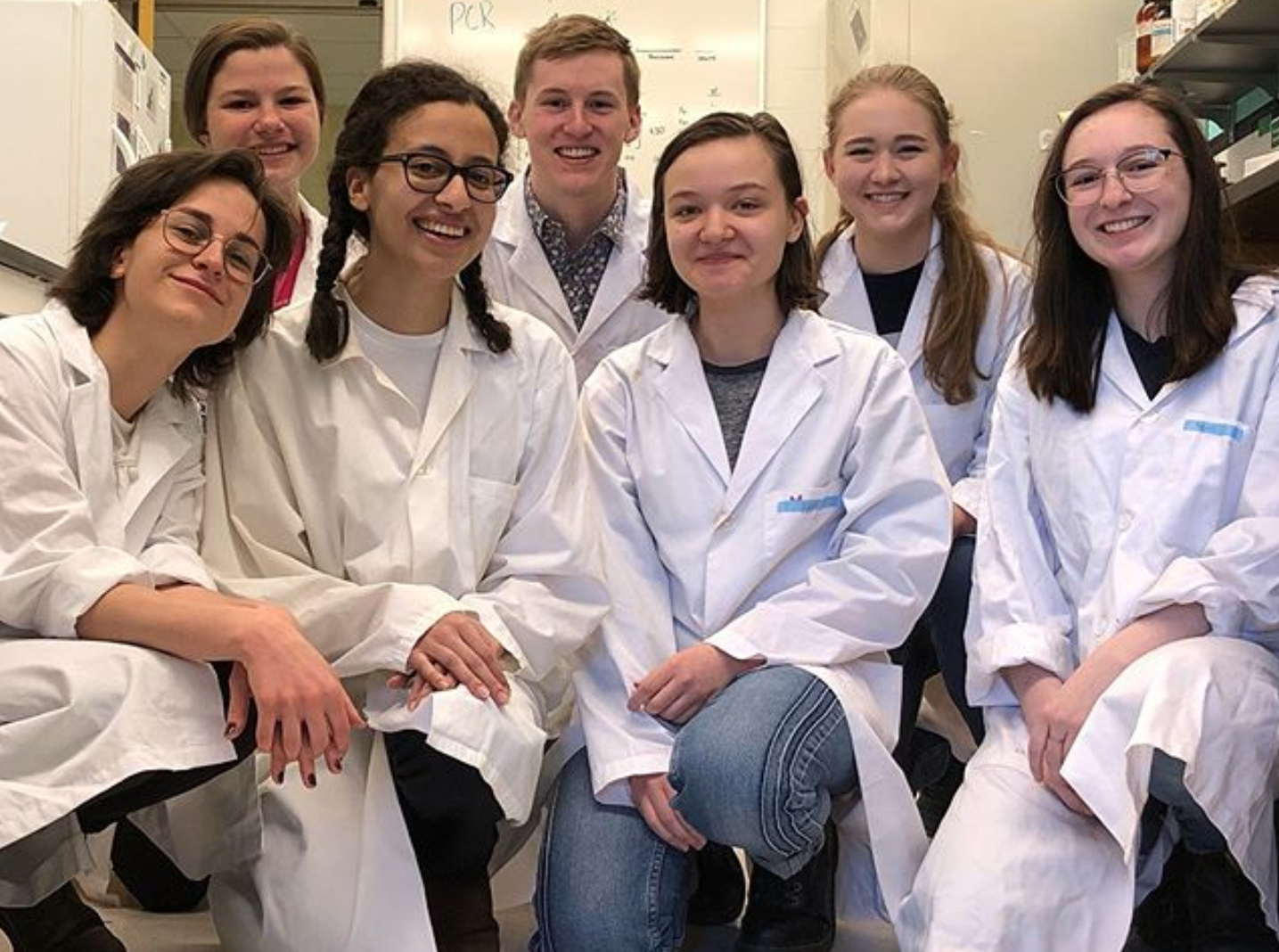 iGEM lab team in lab coats