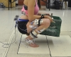 Participant at end range of knee flexion during squat with weighted crate