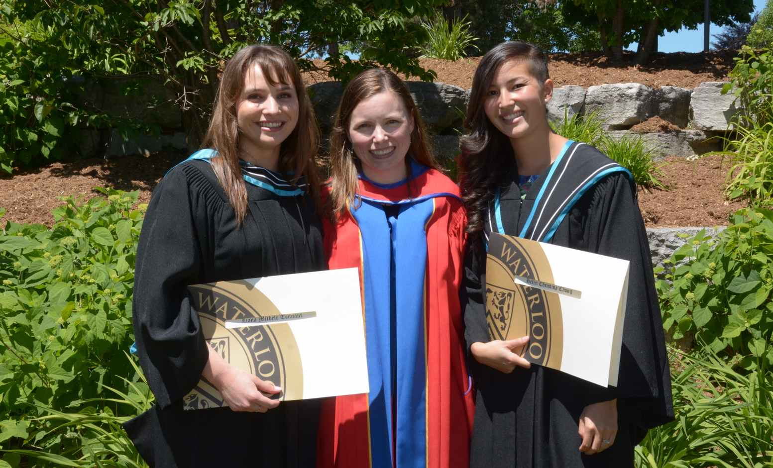 Helen Chong, Liana Tennant, and Stacey Acker in ceremonial robes