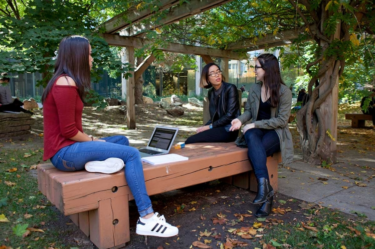 Students talking in a garden