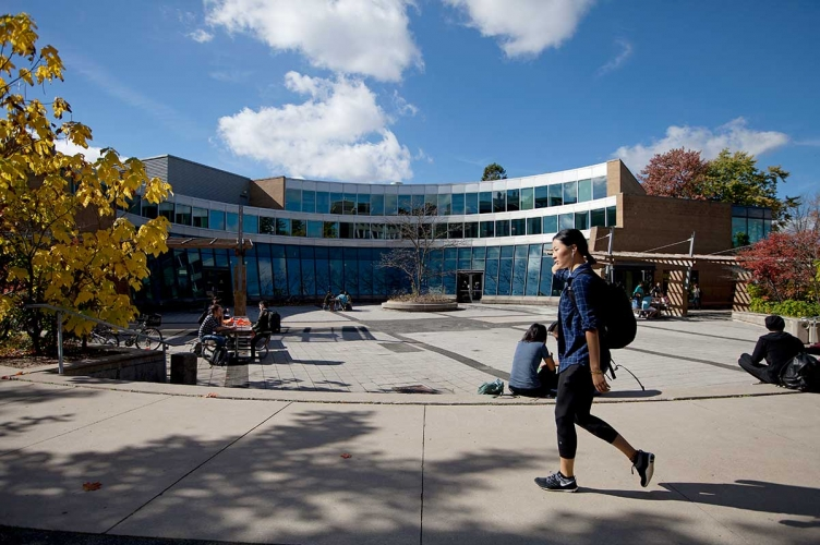 Student walking in front of the Student Life Centre