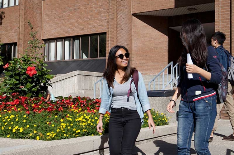 Students walking outside of Hagey Hall