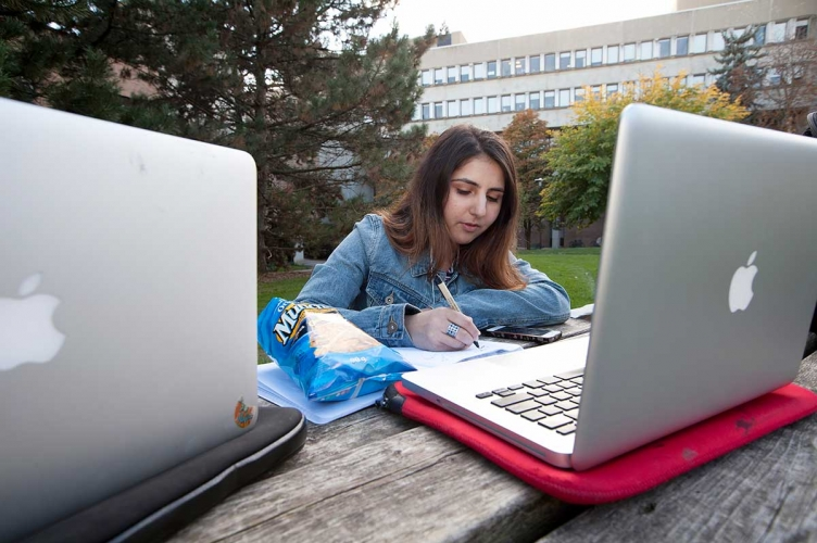 Student working on a laptop outside
