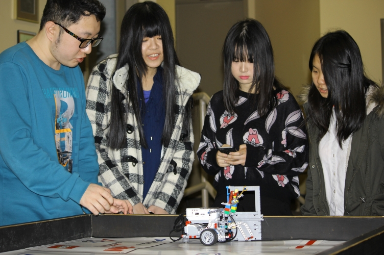 Students participating in a LEGO Robotics challenge