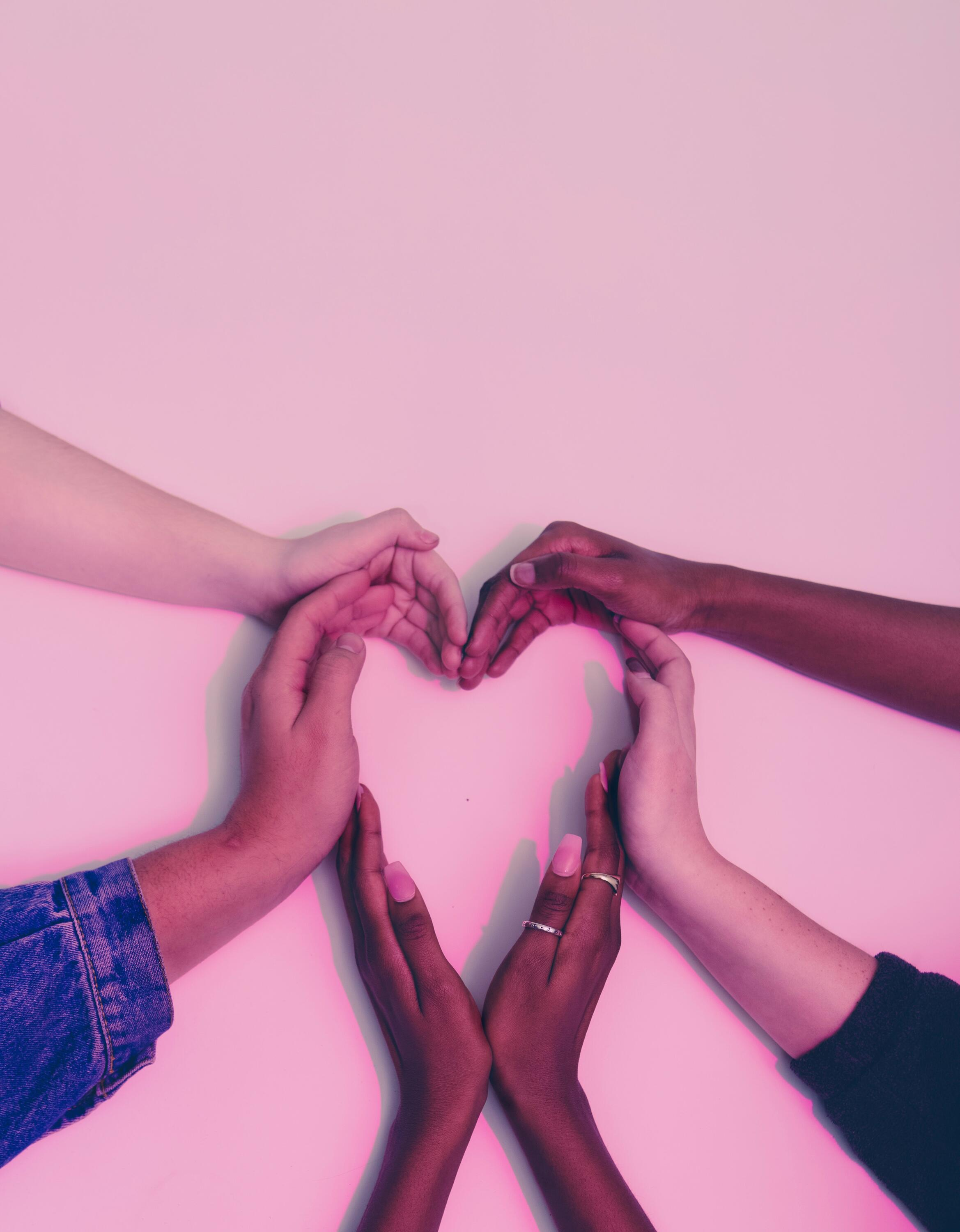 Many hands making a heart