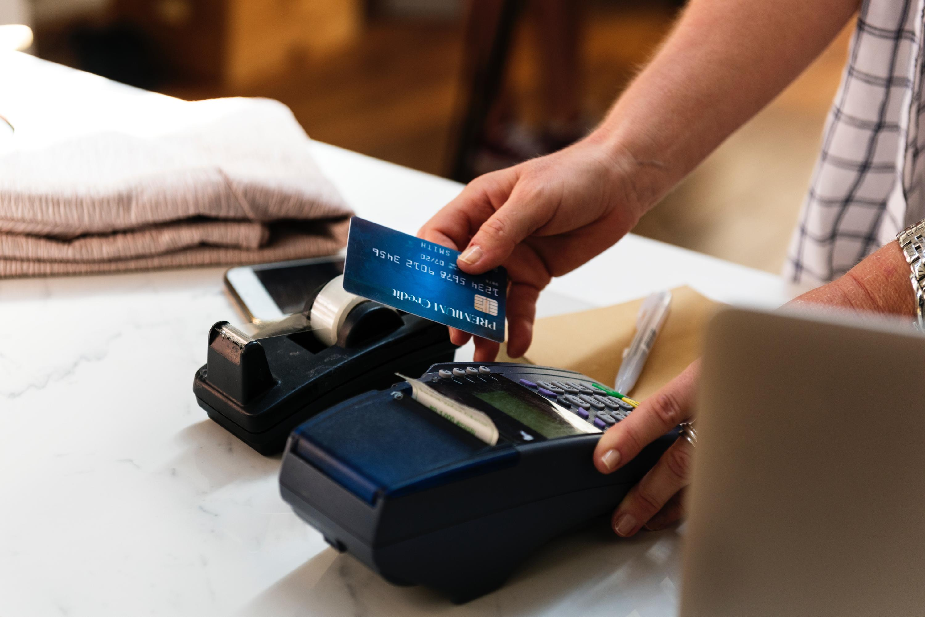 person using point of sale machine