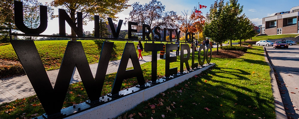 University of Waterloo sculptural metal sign at university entrance.