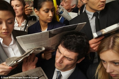 people crammed on a commuter train