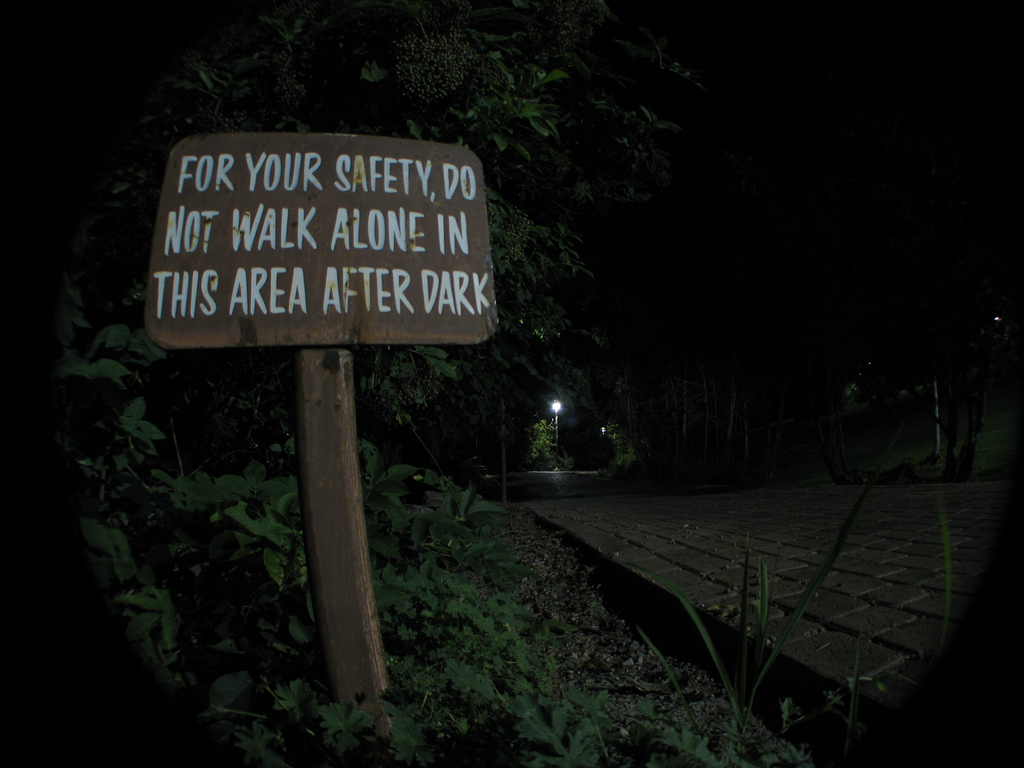Sign that says: for your safety, do not walk in this area after dark
