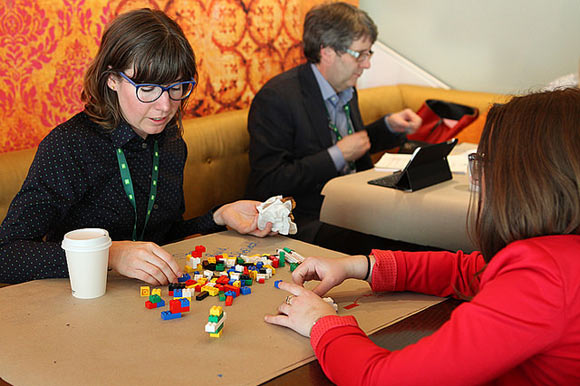 attendees of CKX Summit building lego