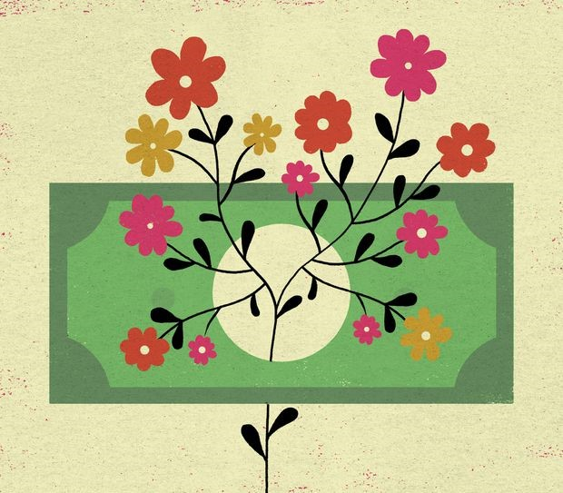 A dollar bill with a bunch of flowers on top